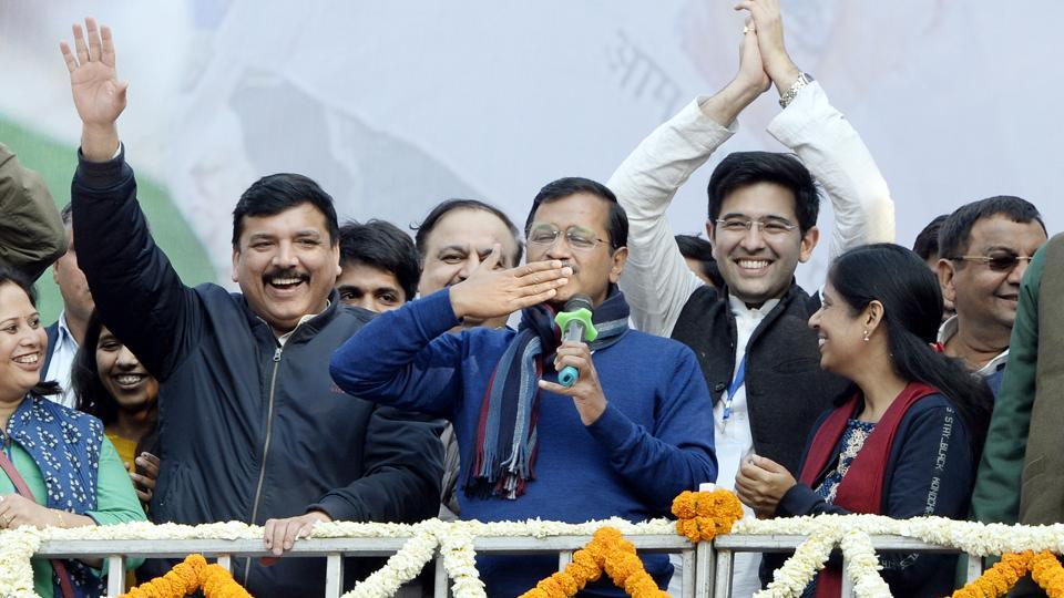 Delhi CM and AAP convenor Arvind Kejriwal (C) gestures during his address to supporters after party's victory in the State Assembly polls, at AAP office in New Delhi, Tuesday, Feb. 11, 2020.