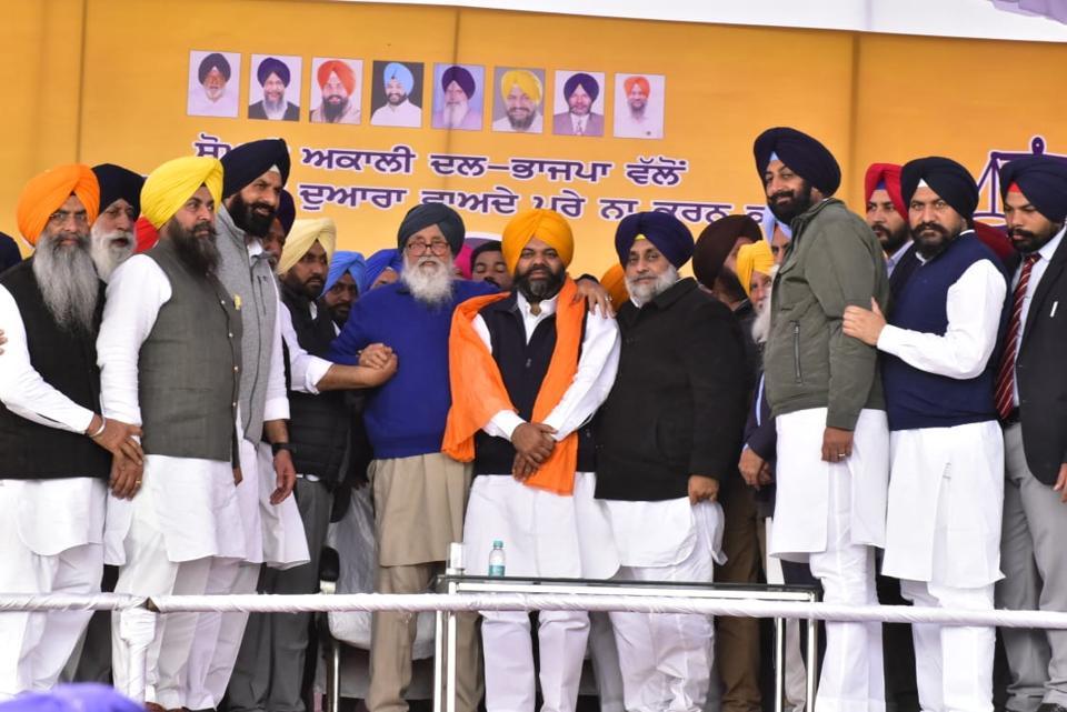 Shiromani Akali Dal patriarch and former chief minister Prakash Singh Badal and SAD president Sukhbir Singh Badal offering a