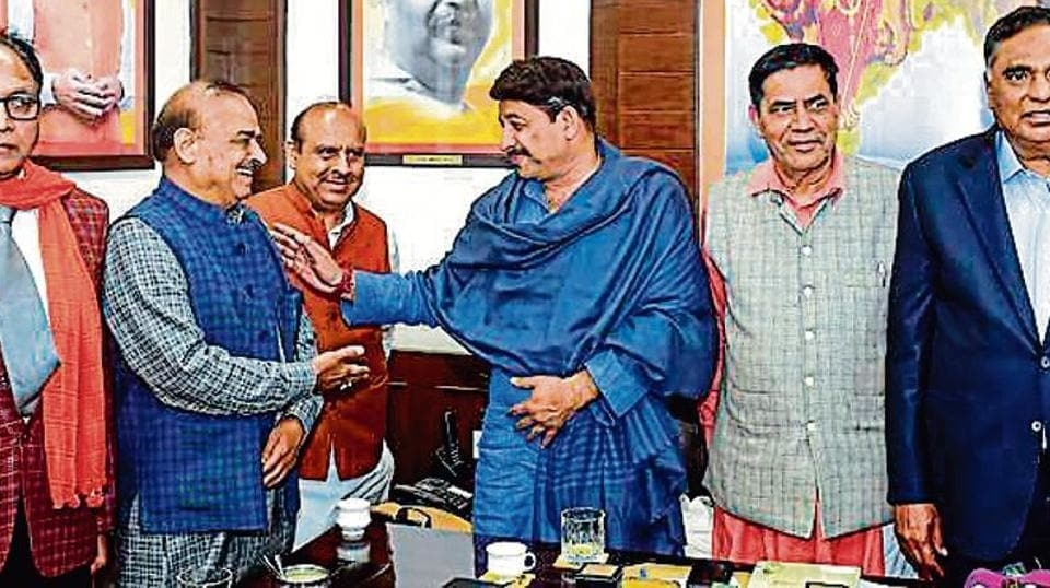 Some of the newly elected BJP MLAs meet Delhi BJP chief and North East Delhi MP Manoj Tiwari on Wednesday.