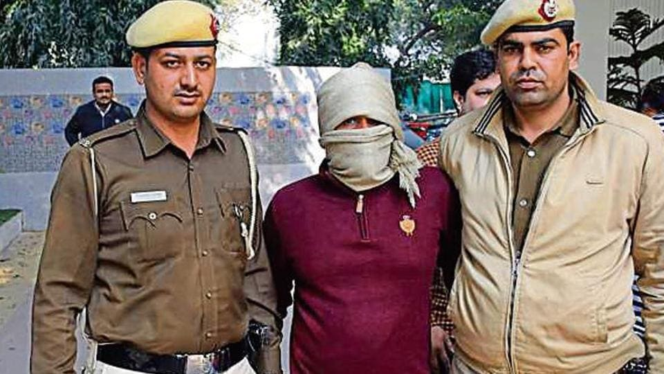 Police with suspect who shot dead an AAP supporter