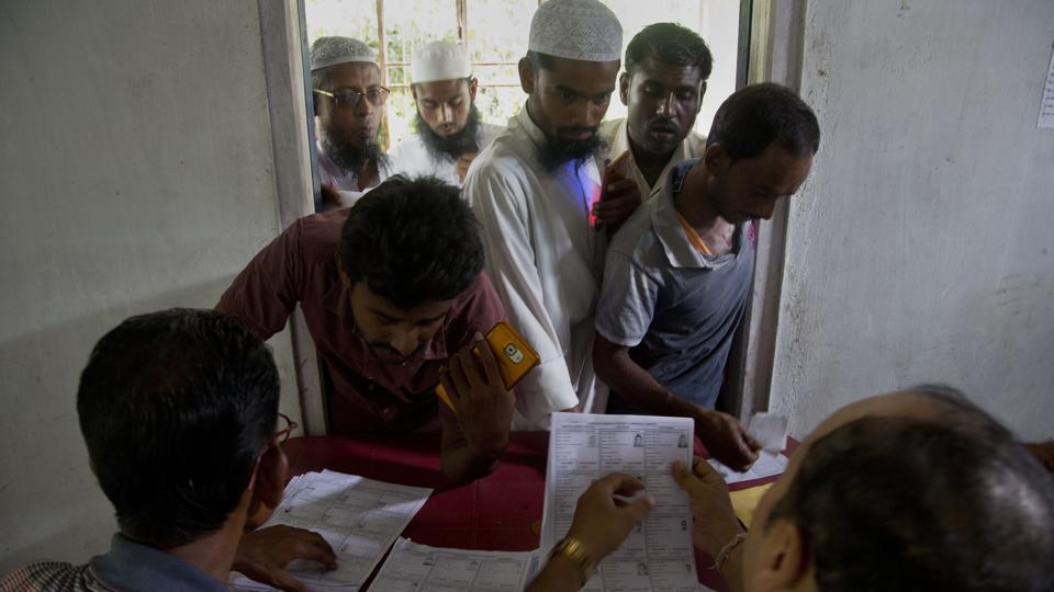 Villagers check for their names in the final list of the National Register of Citizens (NRC) at an NRC centre.