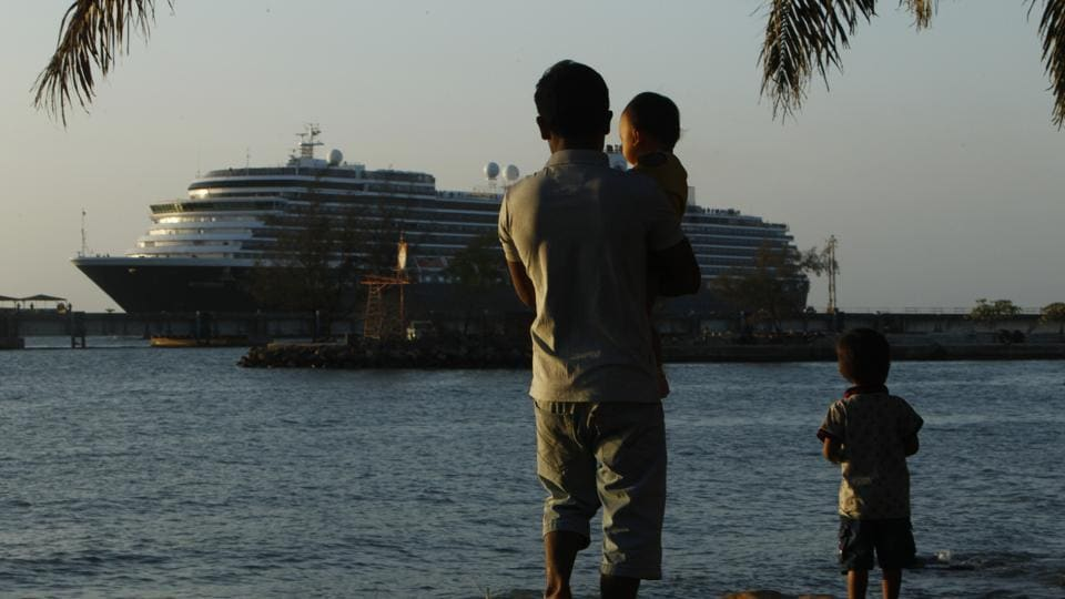 The Westerdam cruise ship, owned by Holland America Line, is docked at the port of Sihanoukville. Westerdam, turned away by 4 Asian and Pacific govts. due to virus fears, anchored Thursday off Cambodia for health checks on its 2,200 passengers and crew.