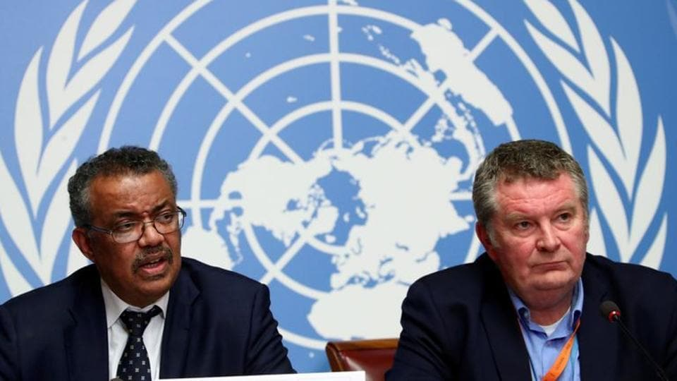 Director-General of the World Health Organization (WHO) Tedros Adhanom Ghebreyesus speaks next to Michael J. Ryan, Executive Director of the WHO Health Emergencies Programme, during a news conference on the situation of the coronavirus.