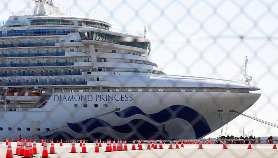 The cruise ship Diamond Princess, where dozens of passengers were tested positive for coronavirus, is seen through steel fence at Daikoku Pier Cruise Terminal in Yokohama, south of Tokyo, Japan, February 11, 2020.