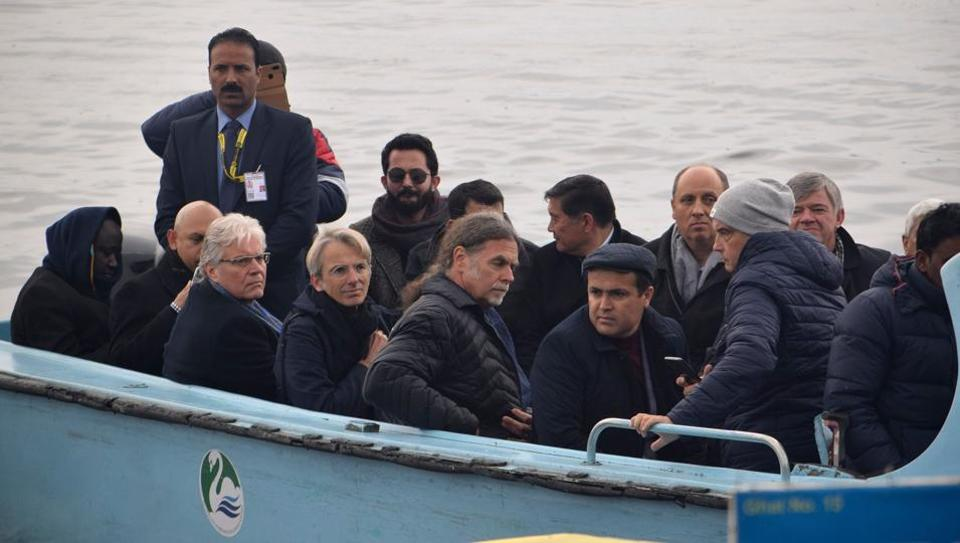 Envoys from foreign countries ride on shikara boat in Dal Lake in Srinagar on February 12, 2020.