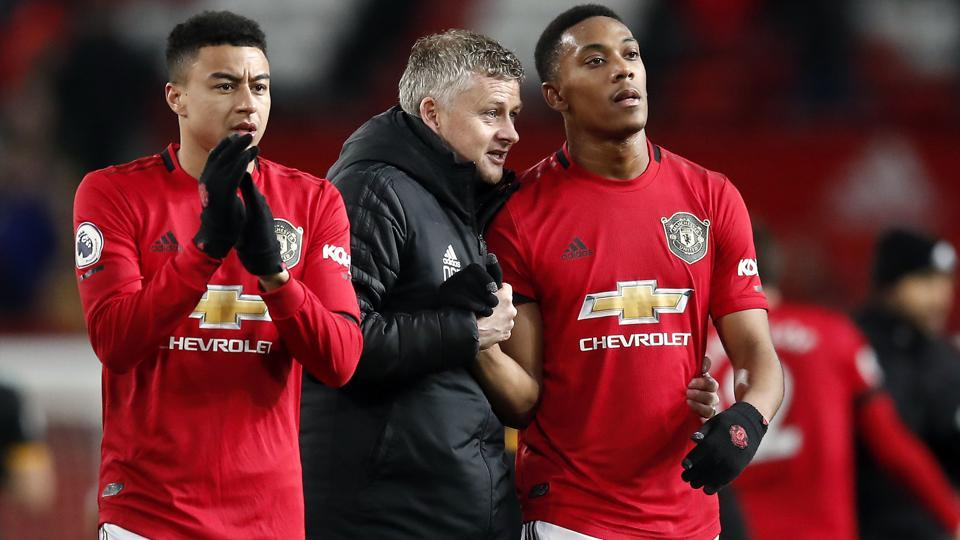 Manchester United manager Ole Gunnar Solskjaer, center, and Anthony Martial, right.