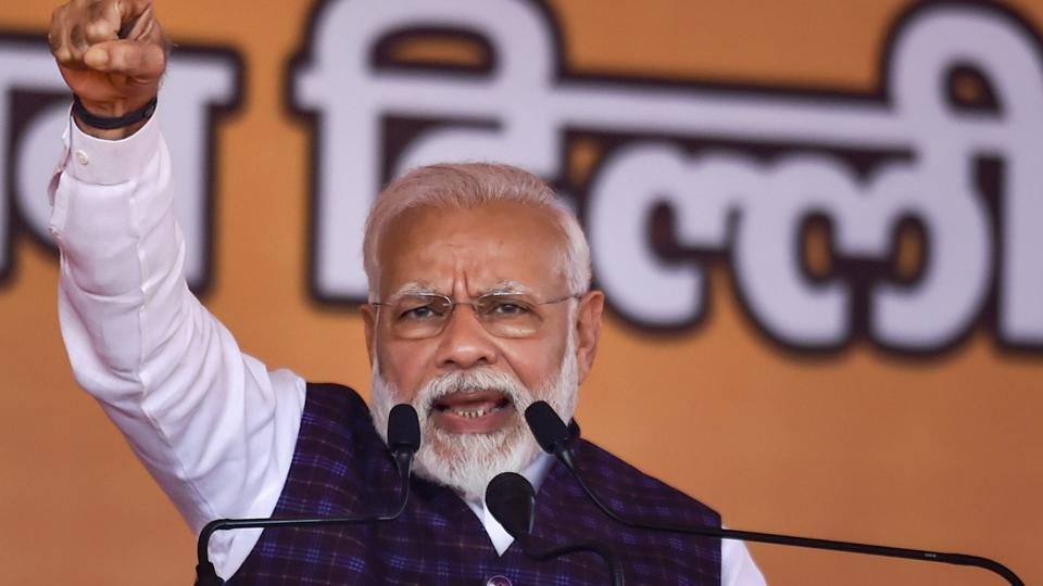 Prime Minister Narendra Modi gestures during an election campaign rally ahead of the State Assembly polls, at Dwarka.
