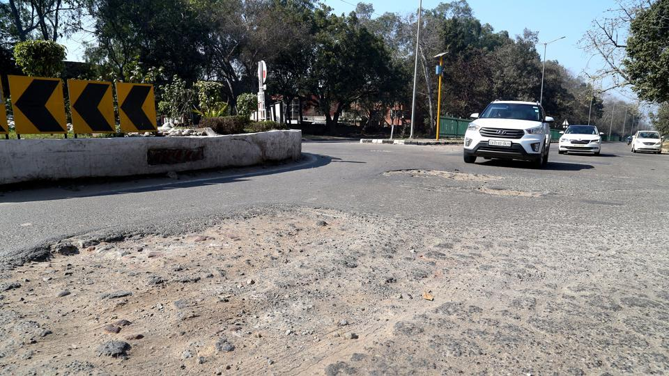The road between Panjab University and Post Graduate Institute of Medical Education and Research, which falls in the mayor's ward, is full of craters.