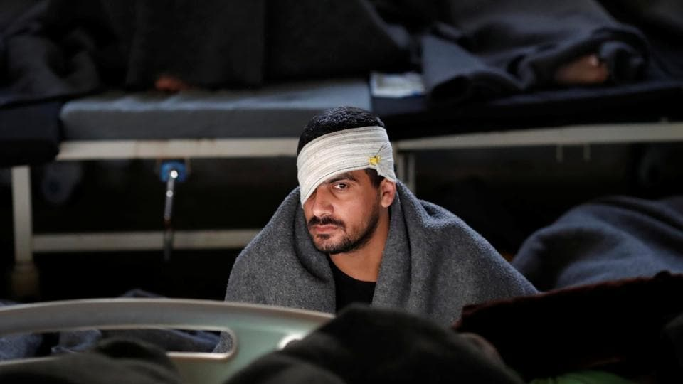 A foreign prisoner with a bandage wrapped around his head, inside a prison hospital in Hasaka. Kurdish forces bear the brunt of looking after those captured as Islamic State collapsed, including hundreds of foreigners who fought alongside local militants to create a self-declared caliphate in the Middle East. (Goran Tomasevic / REUTERS)