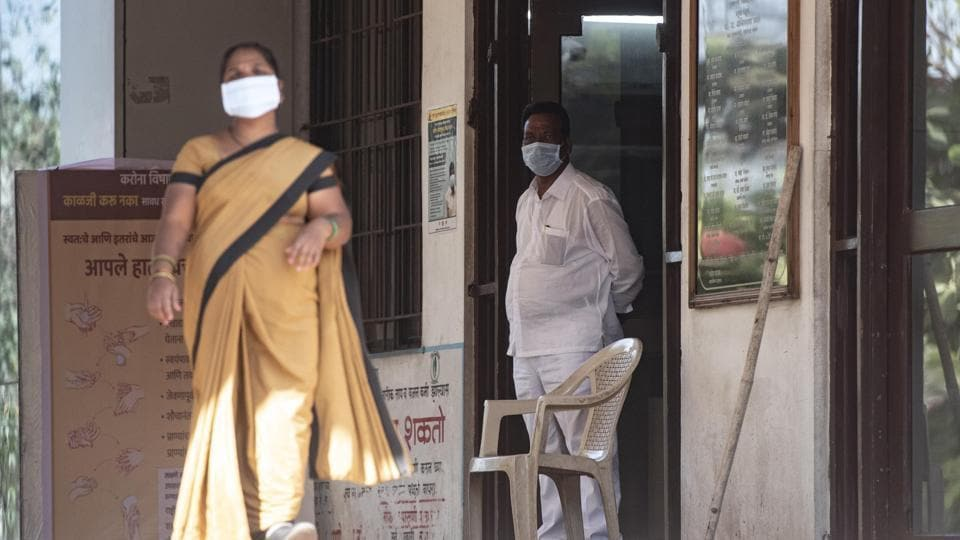 Staff members at Pune's Naidu hospital where a Chinese national was quarantined last week.