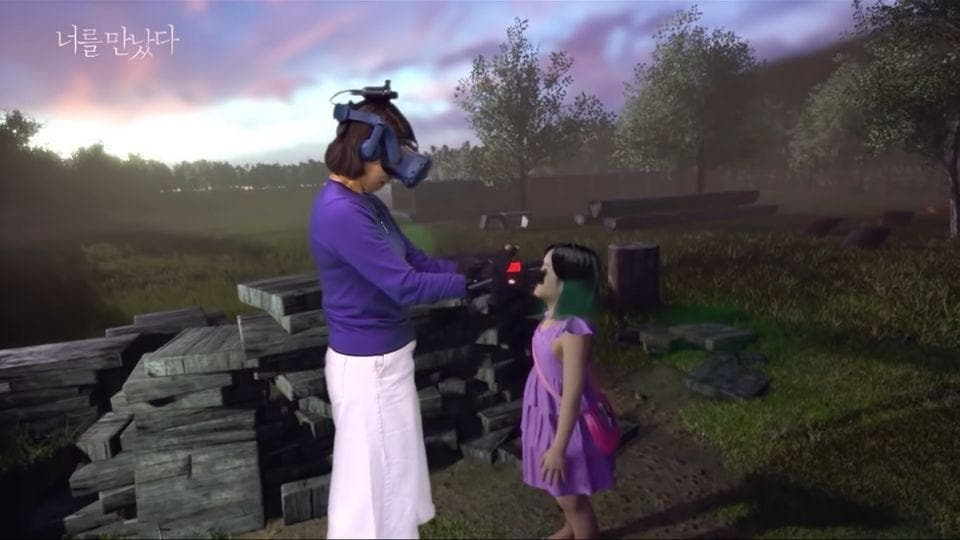 A screengrab from MBCYouTube's channel of a South Korean mother meeting her dead daughter through VR.