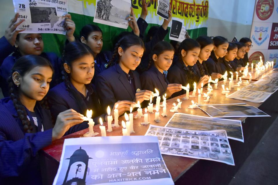 Students pay tribute to the martyred CPPF jawans, who lost their lives in a suicide bomber attack in Pulwama last year, at a school in Amritsar on Friday.