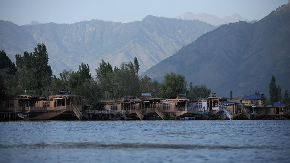 Empty houseboats are seen at Dal lake, in Srinagar.