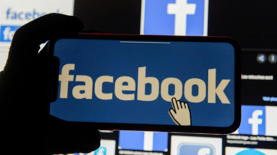 FILE PHOTO: The Facebook logo is displayed on a mobile phone in this picture illustration taken December 2, 2019.
