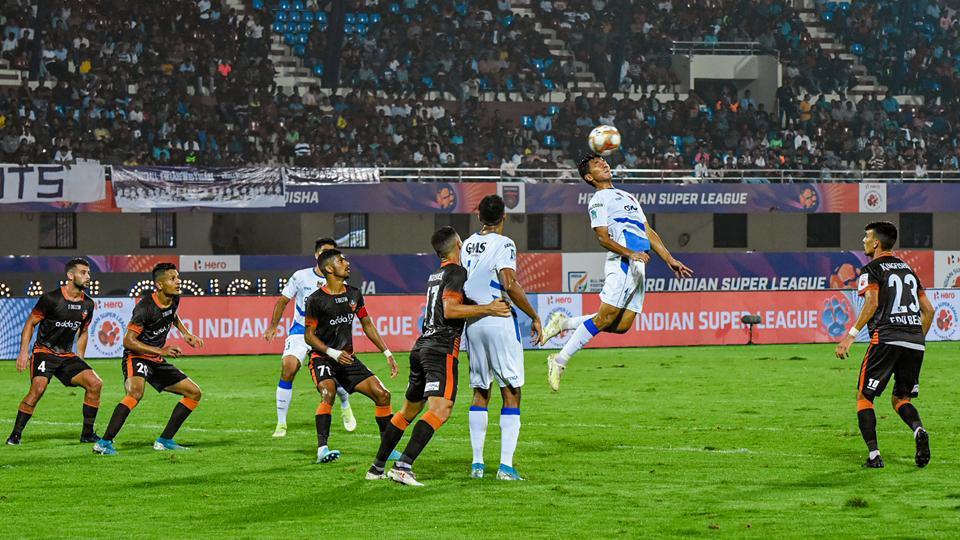 Odisha FC vs GOA FC players during a football match at Kalinga Stadium.