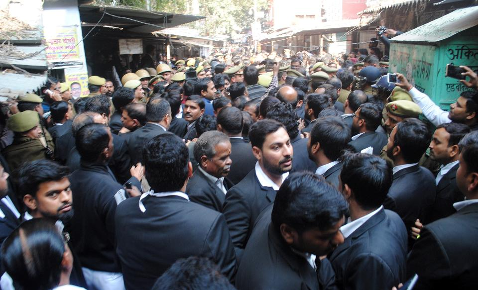 Lawyers at Lucknow District Court premises following a crude bomb blast in Lucknow, Uttar Pradesh on Thursday.
