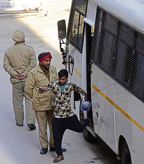 A vendor coming out of a bus ferrying inmates in Ludhiana on February 14.
