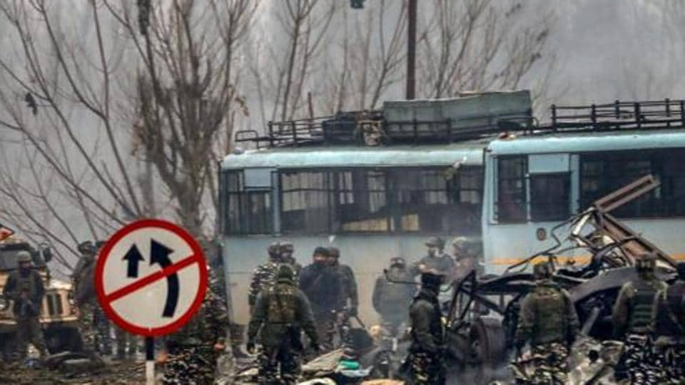 Security personnel carry out the rescue and relief works at the site of suicide bomb attack in Pulwama district of south Kashmir, on February 14, 2019.