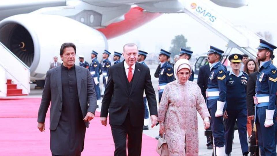 Pakistan's Prime Minister Imran Khan walks with Turkish President Tayyip Erdogan on his arrival in Islamabad, Pakistan.