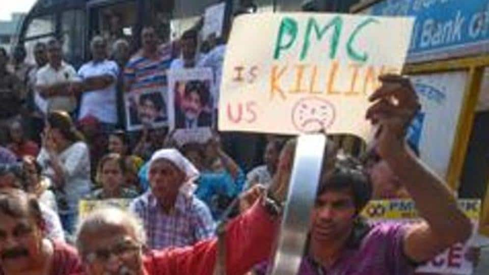 PMC Bank account holders protest in Mumbai. EOWhas filed a supplementary charge sheet in the case throwing more light on the role of Bank's auditors, board of directors and HDIL promoters.