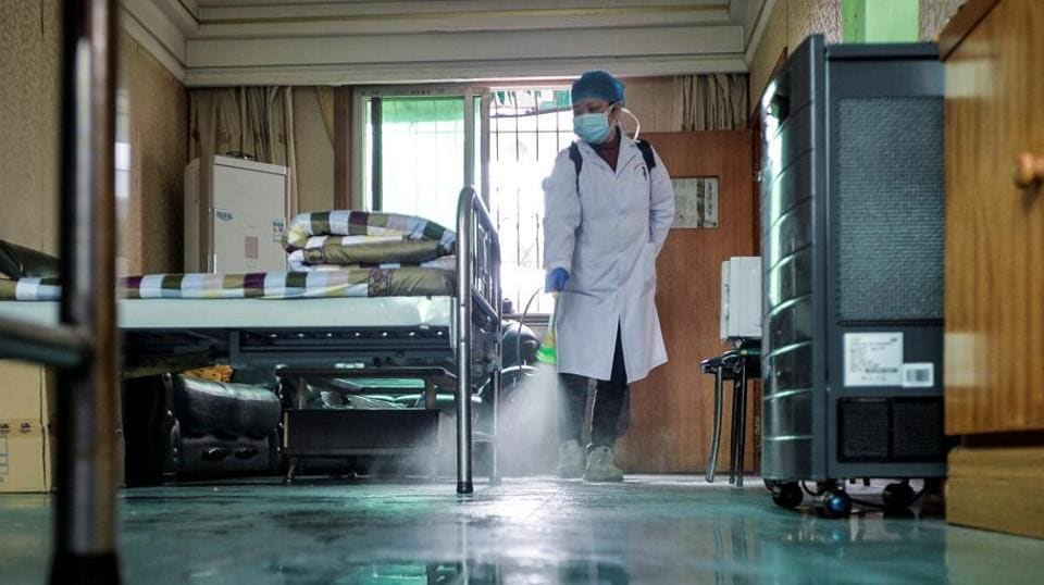 A doctor disinfects a room for medical staff with sanitizing equipment at a community health service centre, which has an isolated section to receive patients with mild symptoms caused by the novel coronavirus and suspected patients of the virus, in Qingshan district of Wuhan, Hubei province, China