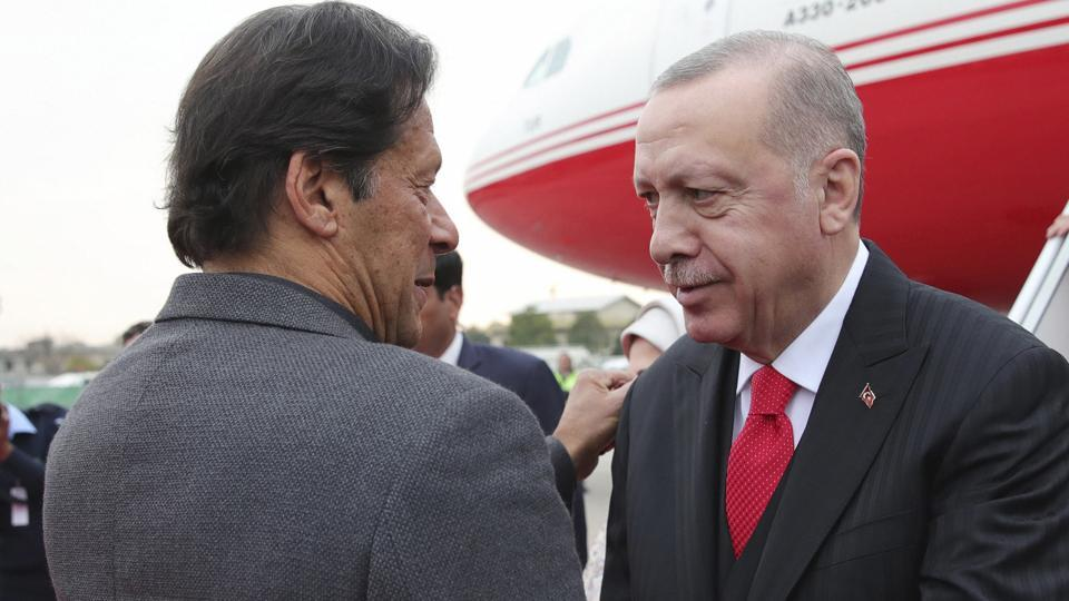 Rawalpindi: Turkey's President Recep Tayyip Erdogan, right, and Pakistan Prime Minister Imran Khan embrace during a welcome ceremony at Nur Khan airbase, in Rawalpindi, Pakistan, Thursday, Feb. 13, 2020. Erdogan is in Pakistan for a two-day state visit. Erdogan's wife Emine Erdogan is at the right. AP/PTI(AP2_13_2020_000178A)