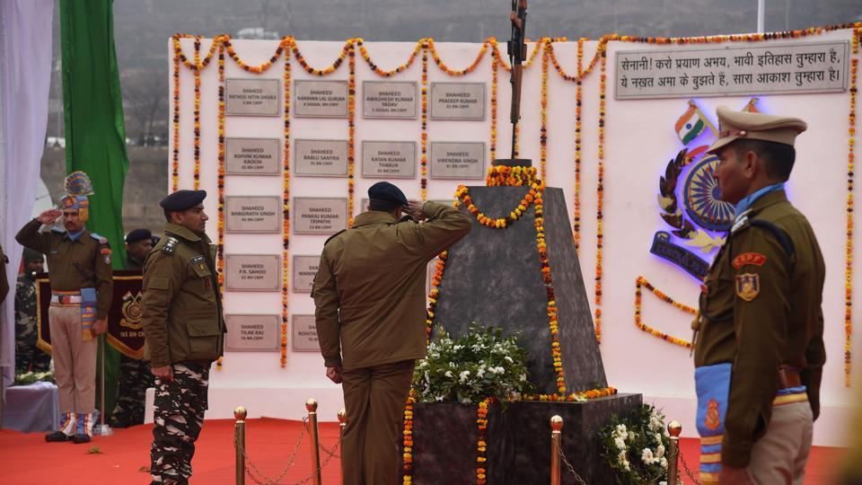 Senior police officer pays tribute to the 40 paramilitary Central Reserve Police Force (CRPF) personnel who were killed in the Pulwama terror attack in February last year, at CRPF battalion headquarter, Lethpoea, Pulwama, Srinagar, Jammu and Kashmir on Febraury 14, 2020.