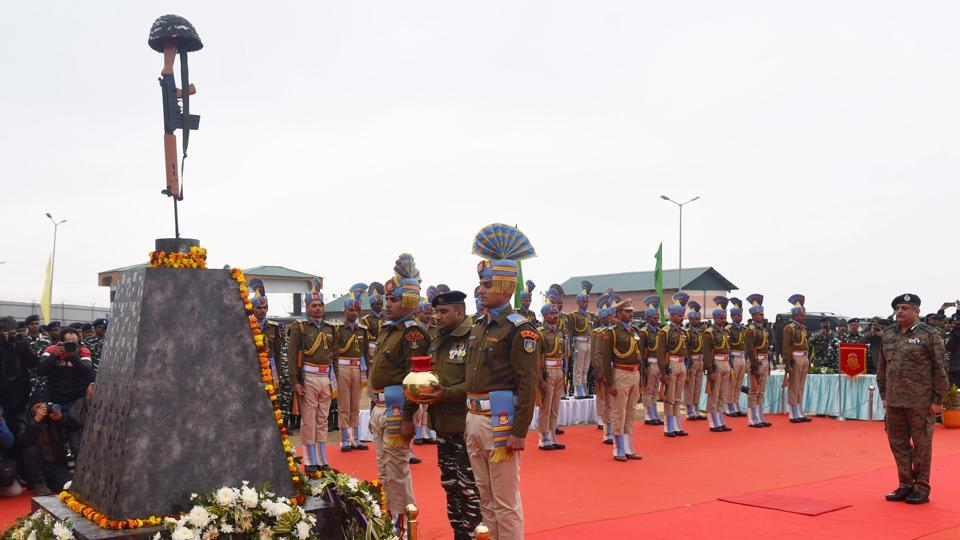"""CRPF personnel pay tribute at a memorial to the 40 CRPF jawans killed in the Pulwama terror attack in February last year, at Lethpora, South Kashmir. """"Tributes to the brave martyrs who lost their lives in the gruesome Pulwama attack last year. They were exceptional individuals who devoted their lives to serving and protecting our nation. India will never forget their martyrdom,"""" PM Modi wrote in a Twitter post. (Waseem Andrabi / HTPhoto)"""