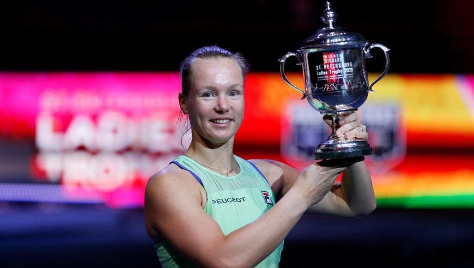 Kiki Bertens celebrates with the trophy after winning the final against Kazakhstan's Elena Rybakina.