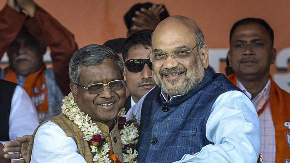Former Jharkhand chief minister Babulal Marandi greets Union Minister Amit Shah during the merger of Jharkhand Vikas Morcha with the Bharatiya Janata Party (BJP), at an event, in Ranchi.