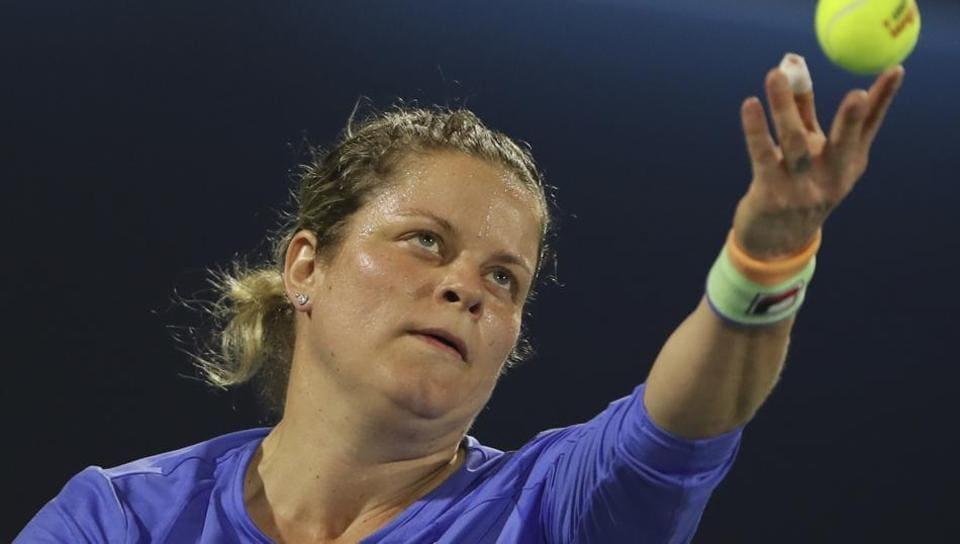 Belgium's Kim Clijsters returns the ball to Spain's Gabrine Muguruza during a match at Dubai Duty Free Tennis Championship.