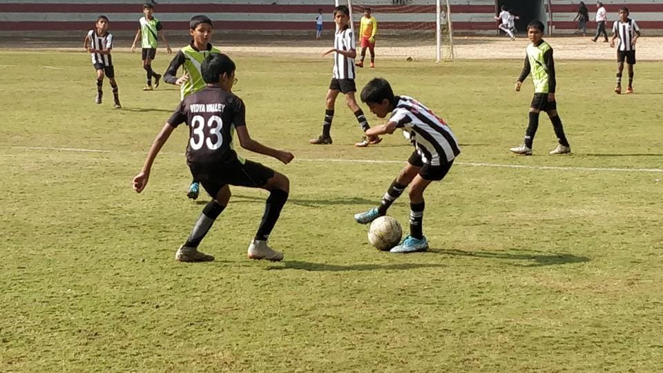 Loyola High School (black and white) and Vidya Valley (brown) in action at the inaugural St Vincent's Junior Inter-School League football tournament.