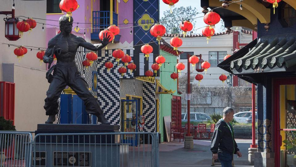 "A man walks past the deserted Los Angeles Chinatown in California. ""It's unfair that a lot of people are scared of Chinese people,"" said Eddie Lau, president of Melbourne's Chinese Chamber of Commerce. ""We tell people, 'we are fine, don't be scared.'"" (Mark Ralston / AFP)"