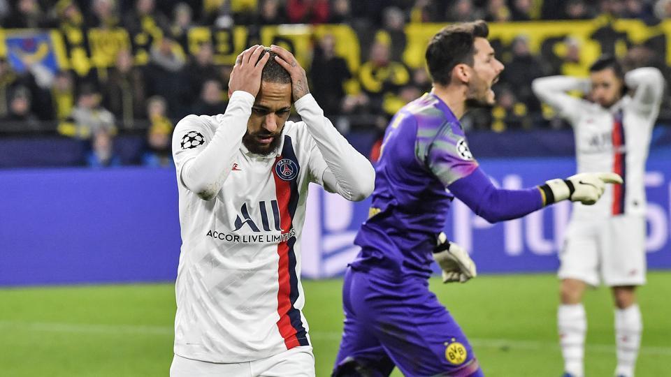 PSG's Neymar reacts disappointed beside Dortmund's goalkeeper Roman Buerki