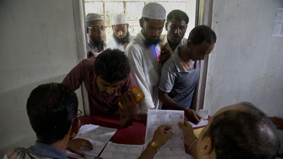 Villagers check for their names in the final NRC list in Buraburi village in Assam's Morigaon district in this file photo.