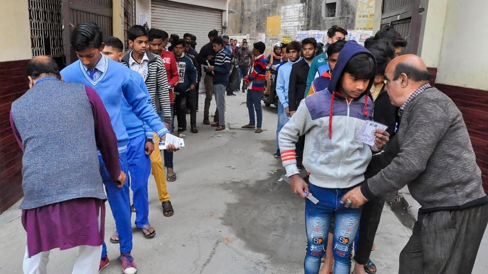 Security personnel frisk examinees before entering the examination hall to appear in the Uttar Pradesh Madhyamik Shiksha Parishad (UPMSP Board) high school (class 10th) and intermediate (class 12th) exams, in Moradabad