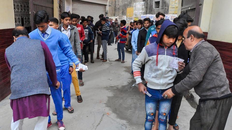 Moradabad: Security personnel frisk examinees before entering the examination hall to appear in the Uttar Pradesh Madhyamik Shiksha Parishad (UPMSP Board) high school (class 10th) and intermediate (class 12th) exams, in Moradabad