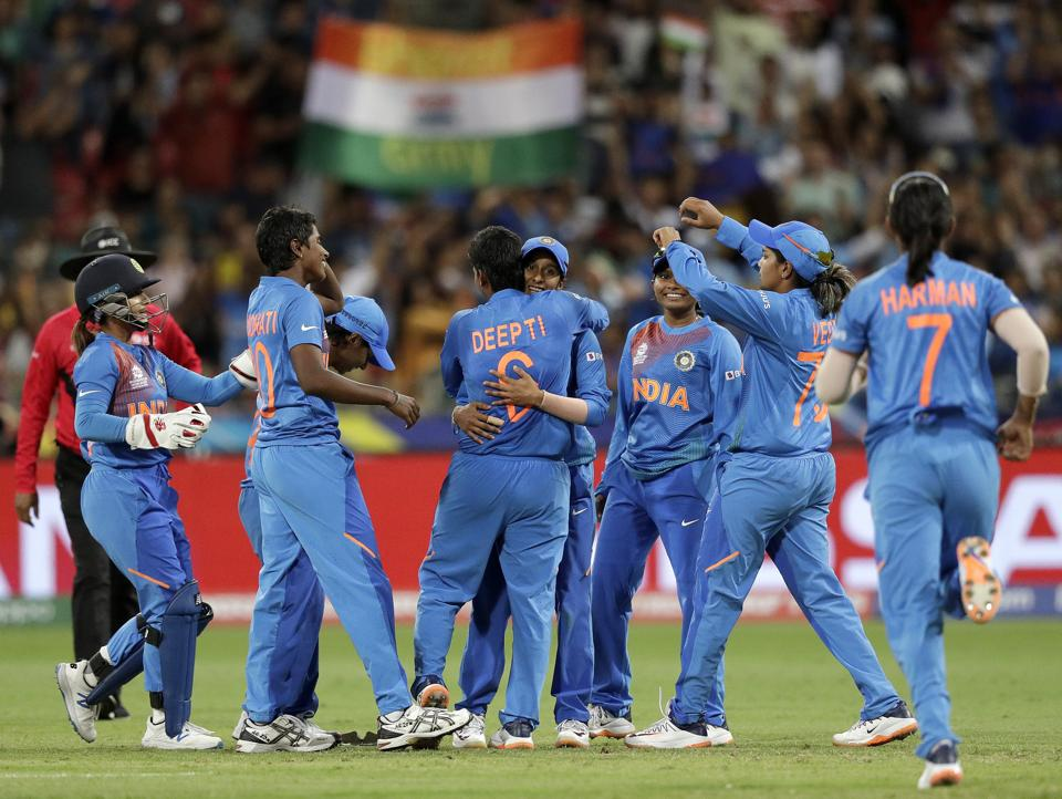 The Indian team celebrate the wicket of Australia's Ashleigh Gardner in the first game of the Women's T20 Cricket World Cup in Sydney. (AP)