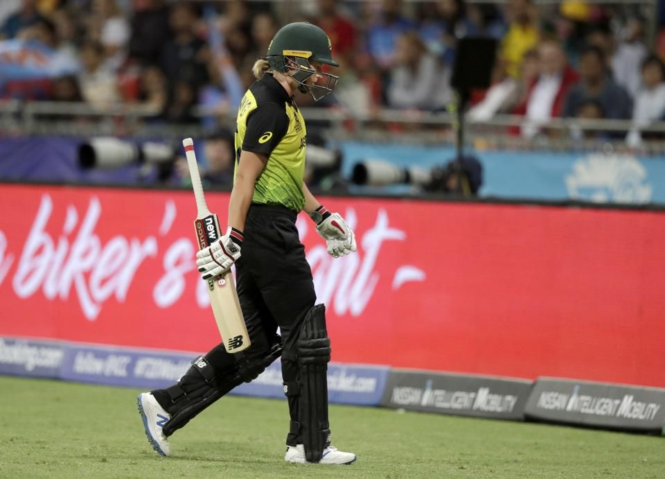 Australia's Meg Lanning walks off after she wast caught behind against India during the first game of the Women's T20 Cricket World Cup in Sydney. (AP)