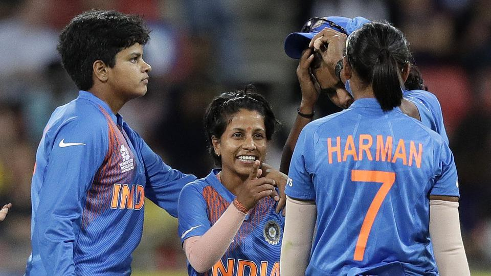 India's Poonam Yadav, center, is congratulated by teammates after taking the wicket of Australia's Rachael Haynes during the first game of the Women's T20 Cricket World Cup in Sydney. (AP)