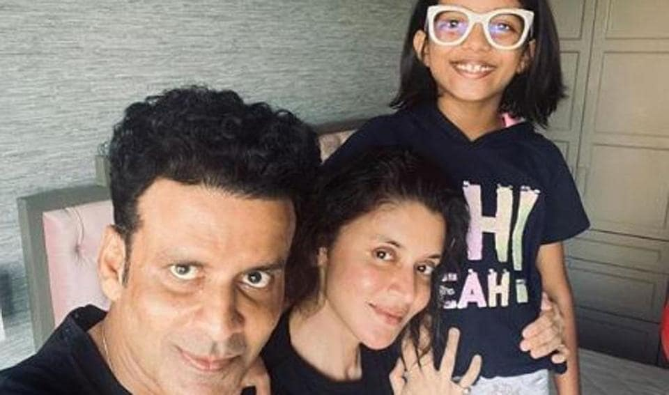Manoj Bajpayee poses with his wife and daughter.