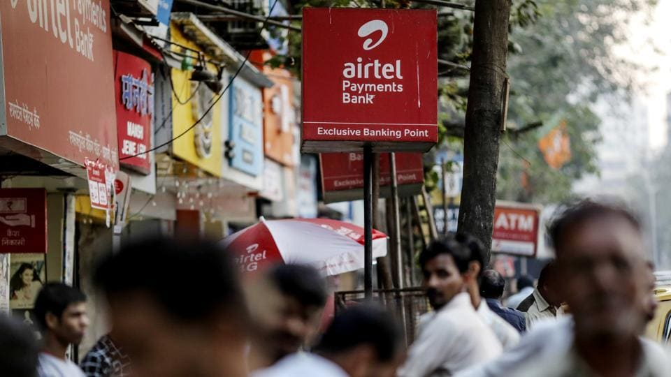 Signage for Bharti Airtel Ltd. stands outside a mobile phone store in Mumbai.