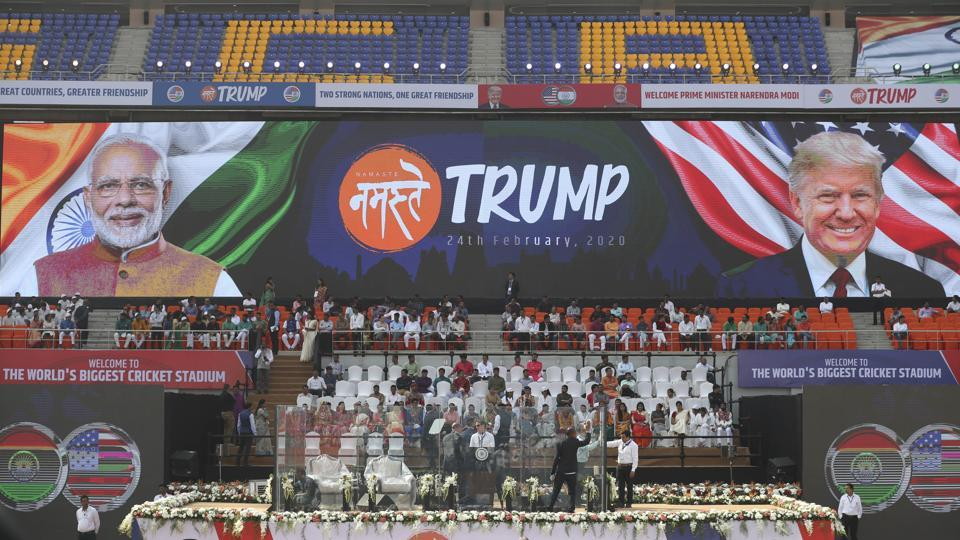 People clean the glass enclosure erected on the podium where U.S. President Donald Trump and Indian Prime Minister Narendra Modi will be seated at Sardar Patel stadium in Ahmedabad.  (AP)