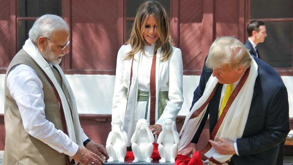 US President Donald Trump with first Lady Melania Trump and Prime Minister Narendra Modi, at Sabarmati Ashram in Ahmedabad on Monday. Amid tight security, Donald Trump and  Narendra Modi held a 22km roadshow in Ahmedabad. After a brief stopover at Sabarmati Ashram, the Trumps and the Prime Minister headed to the Motera stadium. (ANI)