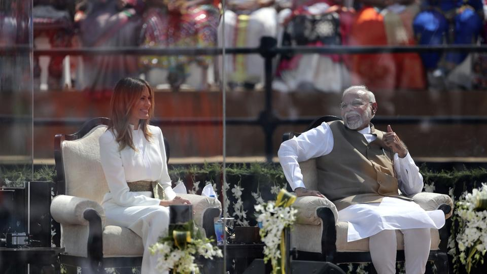 Indian Prime Minister Narendra Modi shares a laugh with First Lady Melania Trump as U.S. President Donald Trump speaks at Sardar Patel Stadium.   (AP)