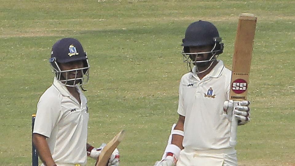 West Bengal batsman A Raman raises his bat after scoring a half century against Odisha during Ranji Trophy quarterfinals against Odisha
