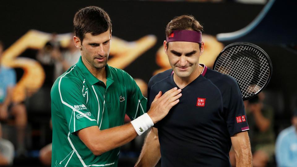 Serbia's Novak Djokovic pats Switzerland's Roger Federer after their match.