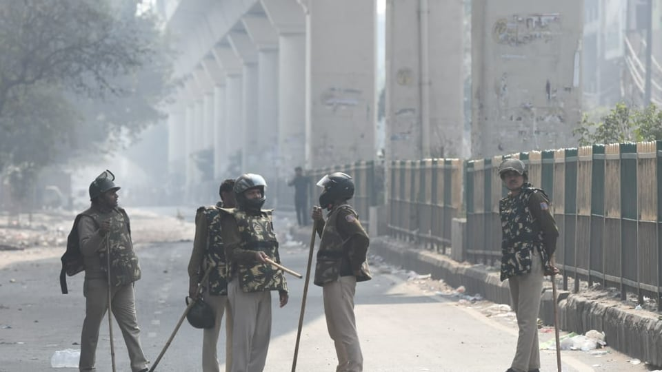 Police personnel at Maujpur area of  northeast Delhi where clashes erupted between two groups over CAA, Feb 25, 2020.