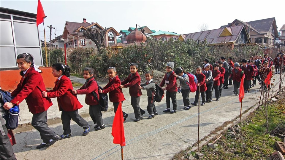 Students of Kashmir queue up to enter their school
