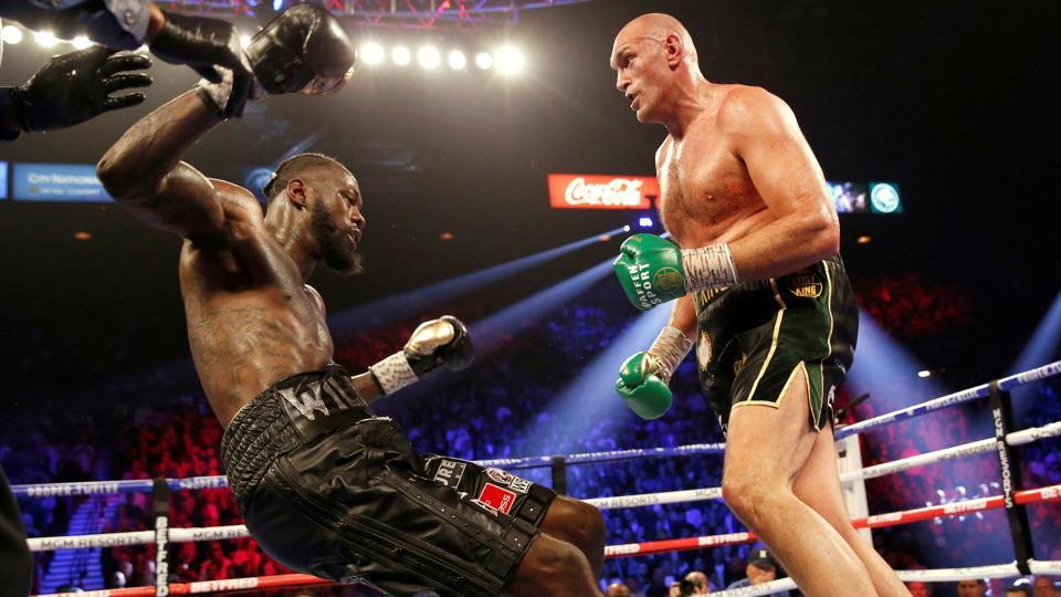 Tyson Fury knocks down Deontay Wilder during the fight.
